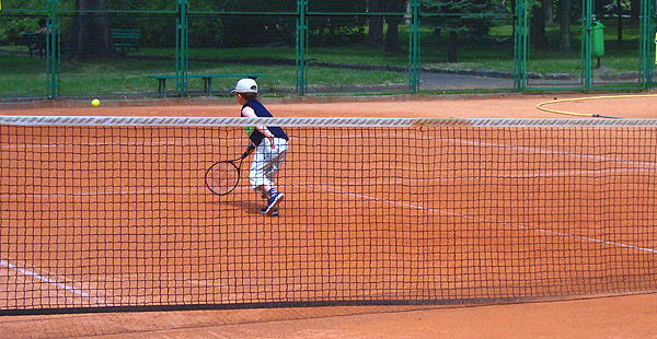 A Krakow boy plays tennis